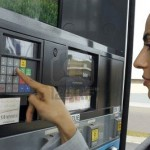 Lady inputting her code at gas pump